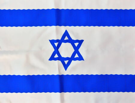 Wavy Israel flag in white and blue showing the Star of David hanging proudly for Israels Independence Day (Yom Haatzmaut) photo