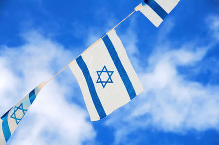 Israeli flags showing the Star of David hanging proudly for Israels Independence Day (Yom Haatzmaut) photo