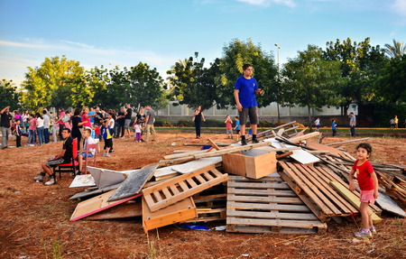 secular: TEL AVIV, ISRAEL - MAY 18, 2014: Secular Israeli Kids having fun at Lag BaOmer with bonfires and food