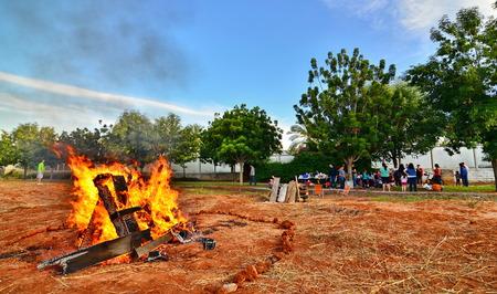 TEL AVIV, ISRAEL - MAY 18, 2014: Secular Israeli Kids having fun at Lag BaOmer with bonfires and food