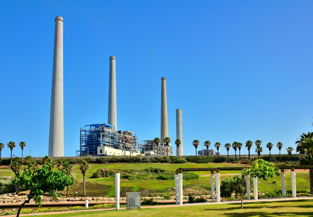 nahal: The Orot Rabin (formerly Maor David) power plant in Hadera, Israel with the Hadera Stream Water Park in the foreground Stock Photo
