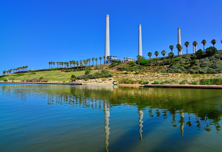nahal: The Orot Rabin (formerly Maor David) power plant in Hadera, Israel with the Hadera Stream Water Park in the foreground - super wide angle view Stock Photo