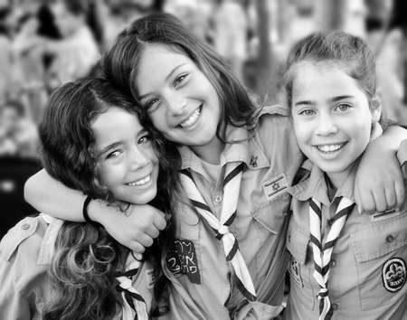 KFAR SABA, ISRAEL - JULY 19: Three unidentified Israel Scouts members aged 11-12 happy and excited upon leaving for summer camp on July 19, 2013 in Kfar Saba, Israel.  Black and White picture.