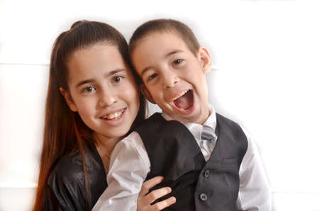 Secular 12-year-old Israeli teenager celebrating her Bat Mitzvah with her younger brother photo