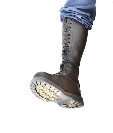 steel toe boots: TEL AVIV, ISRAEL - June 25, 1014: A tall lace-up Grinders combat boot stomping with the sole visible Editorial
