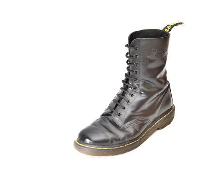 TEL AVIV, ISRAEL - JUNE 25, 2014: A  10 eyelet classic Dr. Martens (docs) black lace-up combat boot