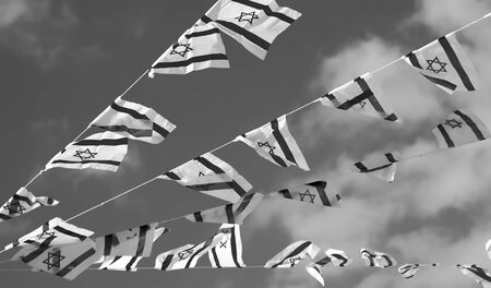 jewish ethnicity: Israel flags in a chain in white and blue showing the Star of David hanging proudly for Israels Independence Day (Yom Haatzmaut) - black and white