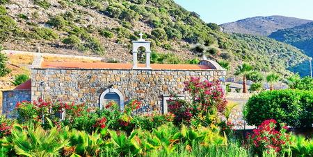 Creten Greek Christian wedding chapel church in beautifully manicured gardens in Malia, Crete, Greece