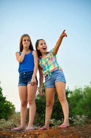 12 year old: Best Friends Forever - two 12 year old teenage girls standing on a hill