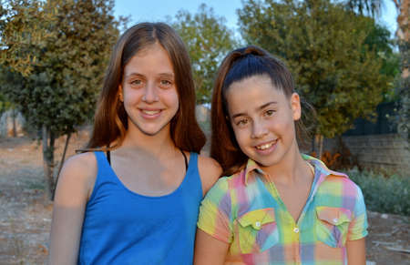 Best Friends Forever - two 12 year old teenage girls  smiling and having fun