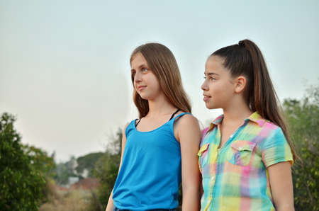 12 year old: Best Friends Forever - two 12 year old teenage girls brooding