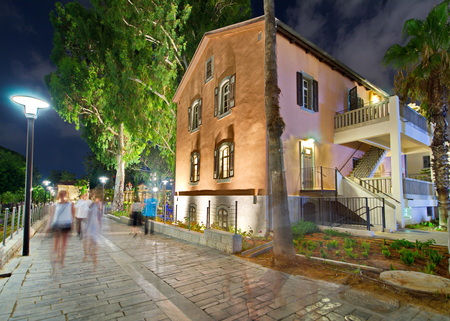 aviv: Tel Aviv Night Life - Restored houses at night at the hip Sarona district featuring rich night life and conserved Templer era German architecture from the late 1800s