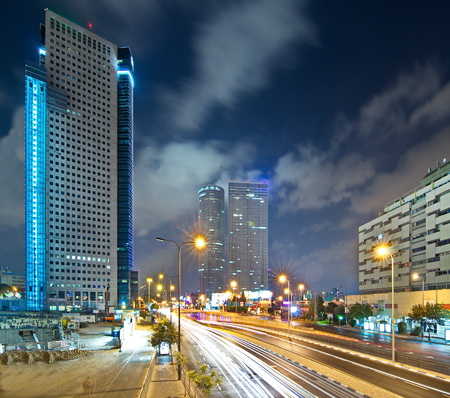 Tel Aviv at Night - Road 20 (Ayalon) the main Tel Aviv expressway at night with car trails and the Tel Aviv moden sky line. Editorial