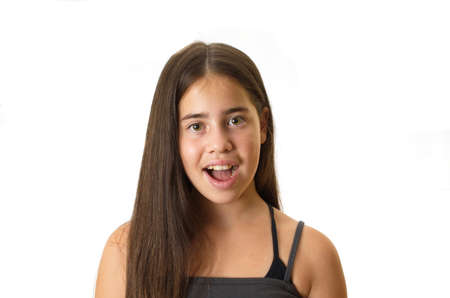 Clean portrait of a surprised 12 year old teenage girl - isolated on white