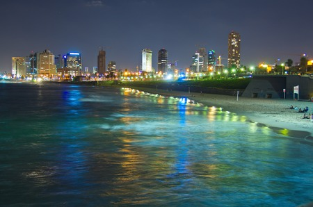 tel: Tel Aviv, Israel skyline coastline reflecting in the Mediterranean Sea