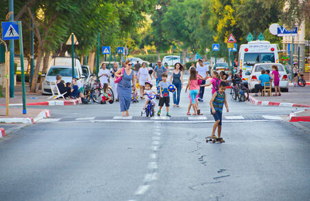 atonement: TEL AVIV - OCT. 4, 2014: People walking and riding in the streets on Yom Kippur (Day of Atonement) in Tel Aviv.  There is little car travel and Israelis freely walk, bike and skate on the streets. Editorial