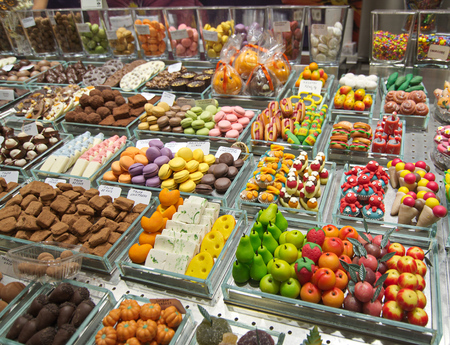 Colorful candy and drinks in the famous Barcelona La Boqueria Market (Mercat de Sant Josep de la Boqueria) in Catalonia, Spain