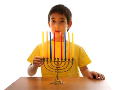6 7 year old: An Israeli 8 year old child lighting a Hanukkah Menorah