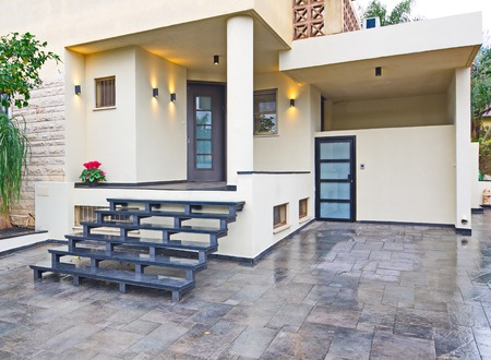 Entrance to a modern Mediterranean house with metal and stone elements photo