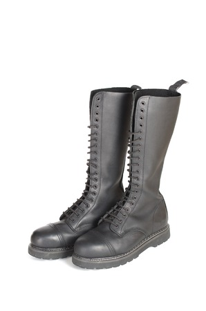steel toe boots: New tall lace-up knee-high black leather boots featuring 20 eyelets and steel-toes.  Fashion combat work boots worn by both men and women. Stock Photo