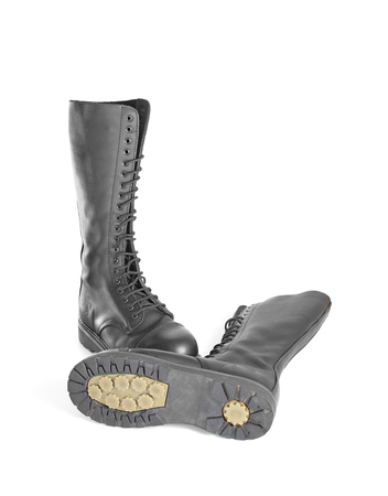 steel toe boots: New tall lace-up knee-high black leather boots featuring 20 eyelets and steel-toes.  Sole is visible. Fashion combat work boots worn by both men and women.