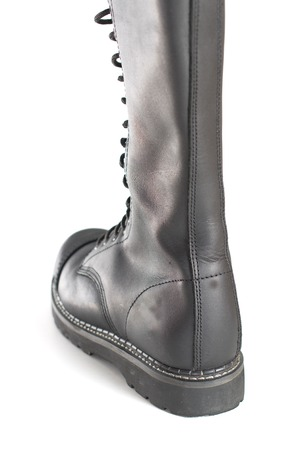 steel toe boots: Back of a new tall lace-up knee-high black leather boot featuring 20 eyelets and steel-toes.  Fashion combat work boot worn by both men and women.