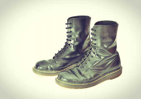 combat boots: A pair of 10 eyelet classic black lace-up combat boots