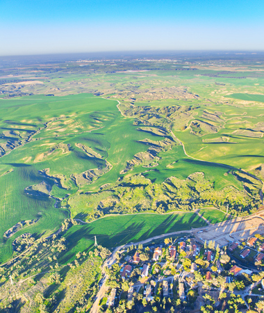 Ballooning over Israel - birds eye view of farm lands and hills near Tel Aviv after the rain, seen from a hot air balloon