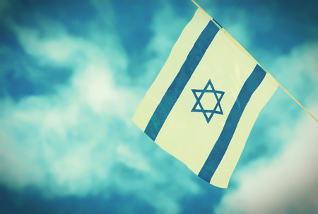 israel: Israel flags in a chain in white and blue showing the Star of David hanging proudly for Israels Independence Day (Yom Haatzmaut) - vintage retro effect