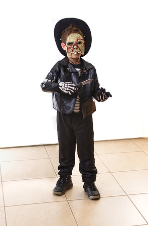8 year old: 8 year old boy dressed as a zombie for Halloween  Purim, holding a toy knife