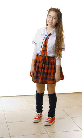 dressed up: Teenage girl dressed up in a 60s college girl costume with a plaid skirt and tie for Purim  Halloween