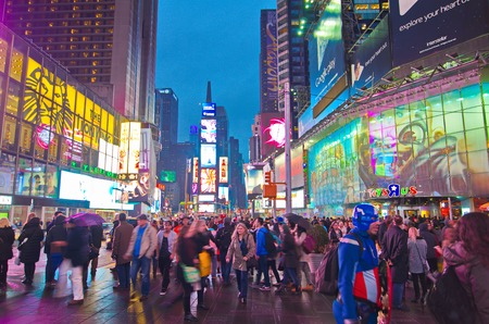 NEW YORK, MARCH 14, 2015: Times Square at night - Busy Broadway with animated signs for the Lion King and other shows.  Theater District is a symbol of New York and the United States. Editorial