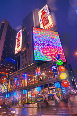 budweiser: NEW YORK, MARCH 14, 2015: Times Square at night - HDR featuring the flagship M&Ms candy store and Budweiser animated signs. Editorial