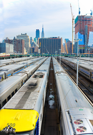 westend: NEW YORK - MARCH 11, 2015: Many trains in a Long Island Railroad parking facility at the west-end of Manhattan, overlooking mid-town and the Empire State Building Editorial