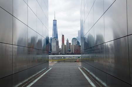 sky line: NEW YORK - MARCH 15, 2015: New York City sky line through the Empty Sky: New Jersey September 11 Memorial with the  missing World Trade Center Twin Towers