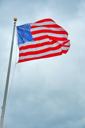 US United States Flag handing proudly over the the Liberty State Park 9/11 Memorial in New Jersey Standard-Bild