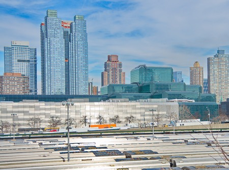 westend: NEW YORK - MARCH 11, 2015: Many trains in a Long Island Railroad parking facility at the west-end of Manhattan, overlooking mid-town buildings Editorial