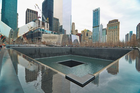 NEW YORK - MARCH 11, 2015: The National September 11 911 Memorial and Museum at the World Trade Center Ground Zero site. The main memorial commemorating the 2001 September 11 attacks on Manhattan.