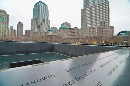 NEW YORK - MARCH 11, 2015: The National September 11 911 Memorial at the World Trade Center Ground Zero site. The main memorial commemorating the 2001 September 11 attacks on Manhattan. Editorial