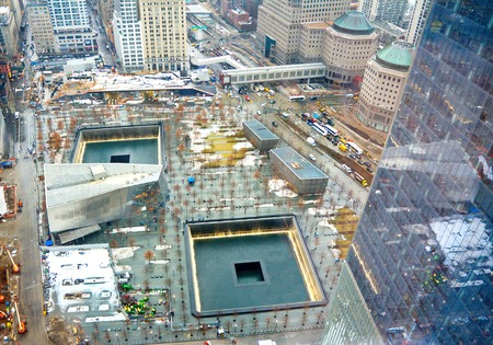 NEW YORK - MARCH 11, 2015: The National September 11 9/11 Memorial and Museum at the World Trade Center Ground Zero site. The main memorial commemorating the 2001 September 11 attacks on Manhattan. Editorial
