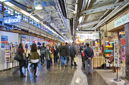 production facility: NEW YORK - MARCH 9, 2015: People shopping in Chelsea Market, Manhattan, New York City - long exposure.  The Market is an enclosed urban food court, shopping mall, and television production facility.