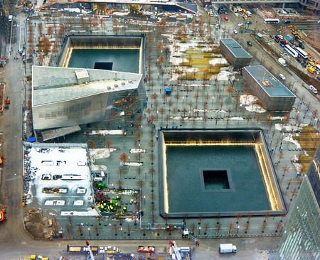 NEW YORK - MARCH 11, 2015: The completed National September 11 911 Memorial & Museum at the World Trade Center Ground Zero site. This is the principal memorial commemorating the September 11 attacks of 2001 on the Manhattan Twin Towers.