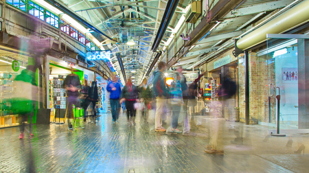 store interior: NEW YORK - MARCH 9, 2015: People shopping in Chelsea Market, Manhattan, New York City - long exposure.  The Market is an enclosed urban food court, shopping mall, and television production facility.