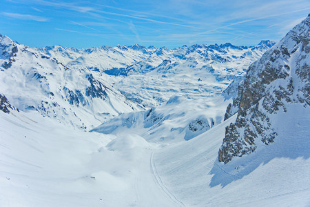 Ski Area: View of the pistes, ski trails, and mountains of the Lech Zurs ski resort, part of the Arlberg  ski area, from a mountainside restaurant. Stock Photo