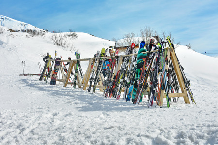 skis: LECH, AUSTRIA - APRIL 10, 2015: A rack packed with skis and poles after a day of skiing at the Lech - Zurs ski resort in Arlberg, Tyrol, Austria