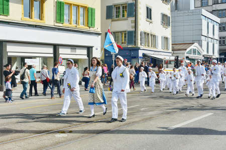 ZURICH, SWITZERLAND - APRIL 13, 2015: People celebrating the Sechselauten (Sachsiluute) - Zurich Spring Festival - celebrated with a parade of the Zunfte (guilds) and burning of the Boogg snowman. Editorial