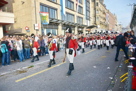 guilds: ZURICH, SWITZERLAND - APRIL 13, 2015: People celebrating the Sechselauten (Sachsiluute) - Zurich Spring Festival - celebrated with a parade of the Zunfte (guilds) and burning of the Boogg snowman. Editorial