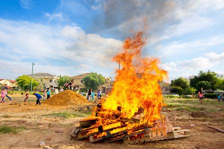 TEL AVIV, ISRAEL - MAY 3, 2015: Elementary school kids participating in festive Lag Baomer bonfires in a secular suburb of Tel Aviv, Israel Editorial
