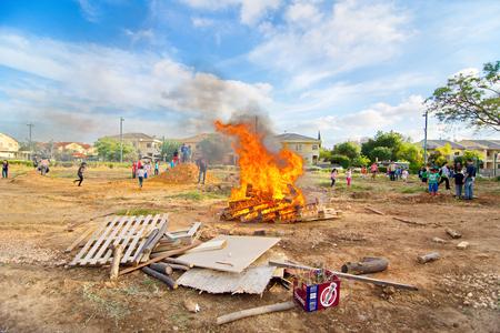 secular: TEL AVIV, ISRAEL - MAY 3, 2015: Elementary school kids participating in festive Lag Baomer bonfires in a secular suburb of Tel Aviv, Israel Editorial