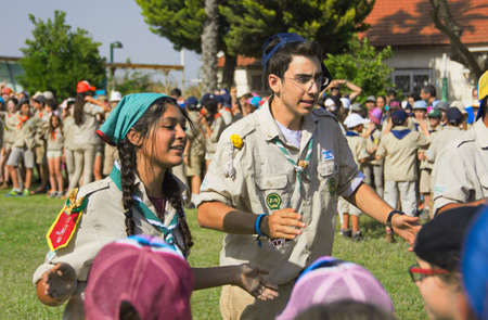 scouts: TEL AVIV - MAY 9, 2015: Unidentified Israel Scouts youth leaders aged 16-17 celebrating in a yearly graduation passage ceremony in a Tel Aviv suburb